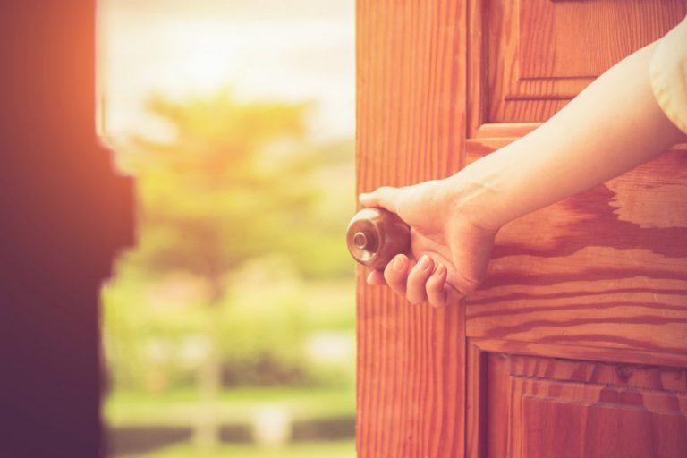 Woman's hand opening a door